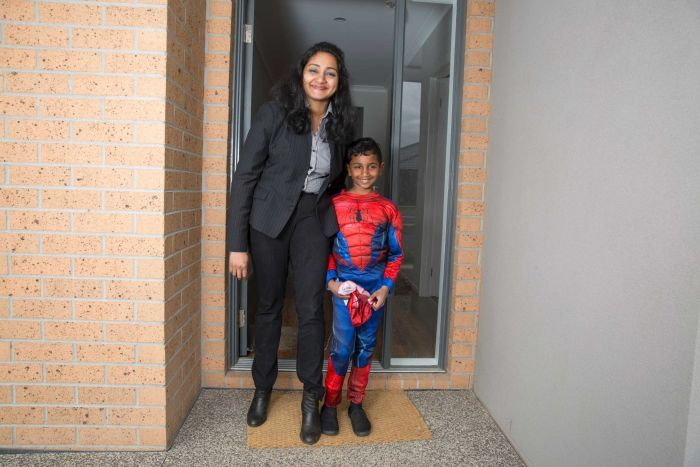 Single mother Paurnami Jitesh and her son Dev out the front of their home.
