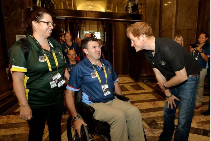 Garry Robinson with Prince Harry.
