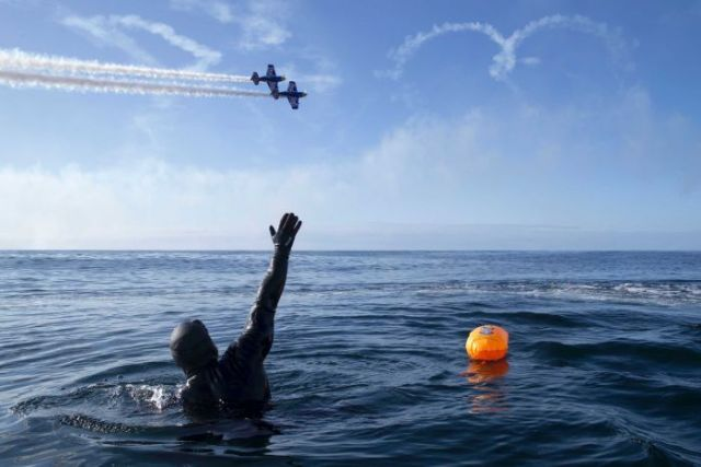 British adventurer Ross Edgley celebrates 100 days at sea, a moment marked by a fly over from an aerobatic display team.