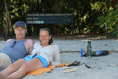 Tamie and Eddie Cleaver lay on the beach near a sign of Zoe Bay on Hinchinbrook Island off north Queensland.