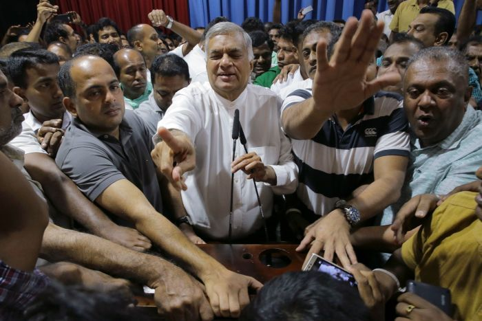 Ousted Prime Minister Ranil Wickremesinghe with supporters