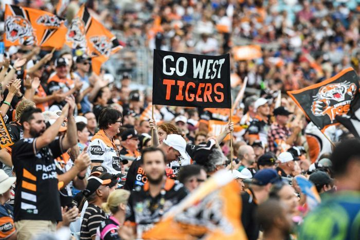 Wests Tigers fans hold a banner