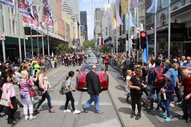 Looking down Bourke St mall, with cars parked in a line before parade.