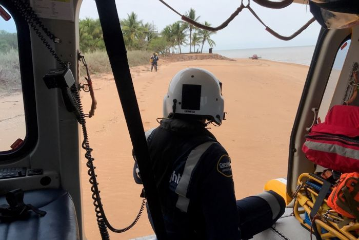 A picture from inside the helicopter, looking out onto the beach