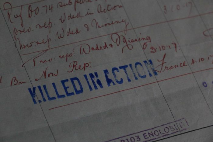 """Paperwork showing the words """"killed in action""""."""