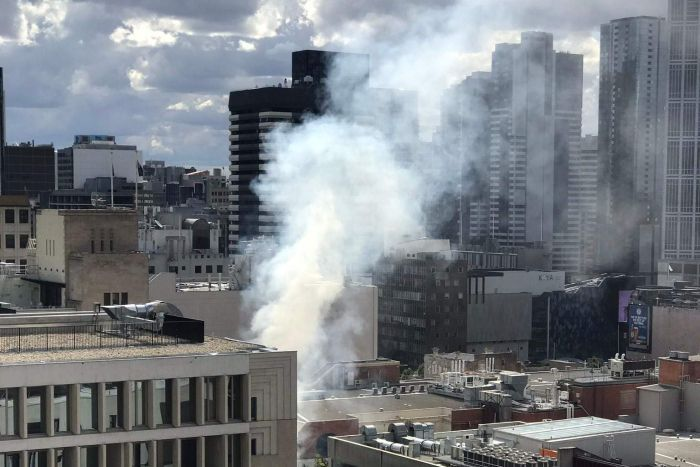 Smoke rises over the Melbourne CBD.