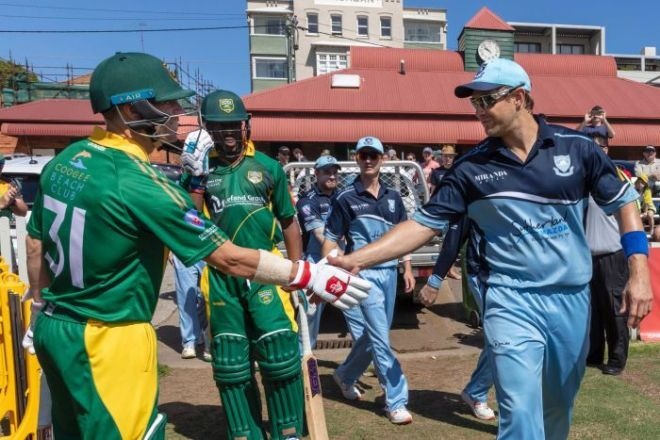 David Warner shakes hands with Shane Watson at the New South Wales grade cricket match at Coogee Oval.
