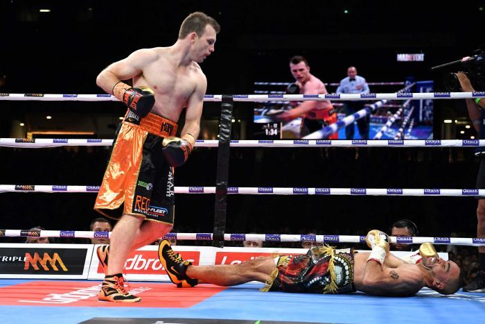 Jeff Horn looks over Anthony Mundine on the canvas