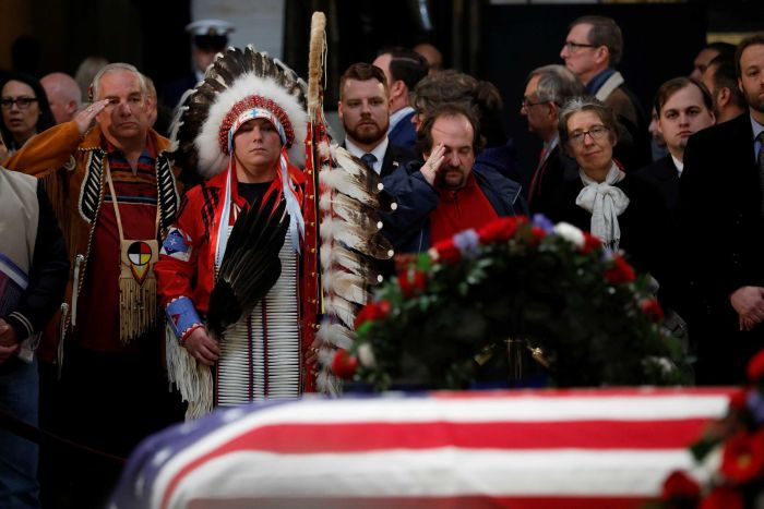 Mourners pay their respects at the casket of former US president George HW Bush as it lies in state.