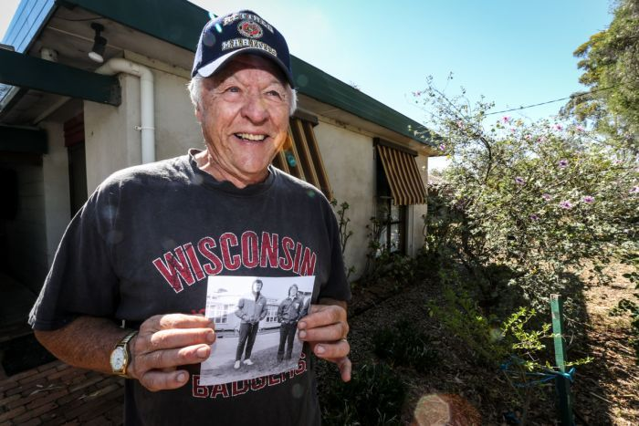 A beaming Roger Dellwo standing outside his house in Bendigo