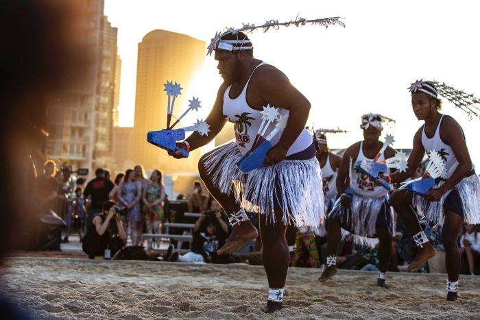 Colour photo of Dance Rites finalists URAB Dancers performing at sun down in sand circle.