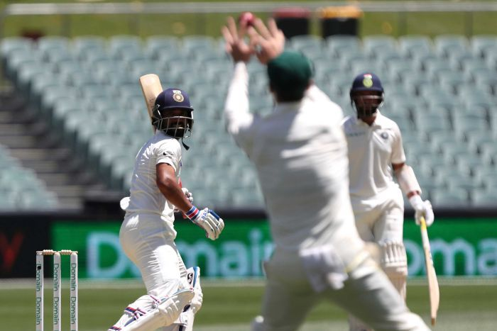 Peter Handscomb takes a catch off Rahane
