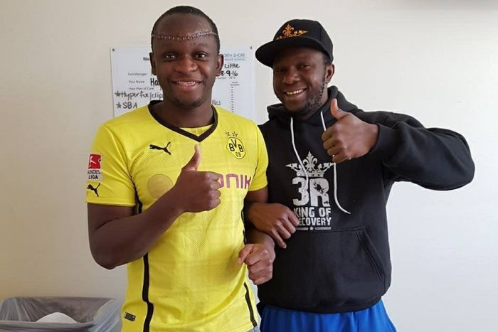 Yusuf Kamara smiles and poses with his brother.
