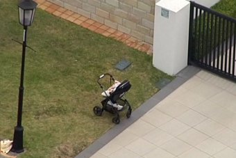 A pram at the scene of a fatal accident in which a 1 year-old boy was killed on the Gold Coast.