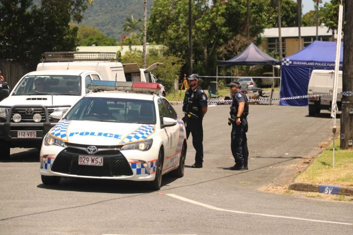 Police cars and officers at a crime scene in Cairns.