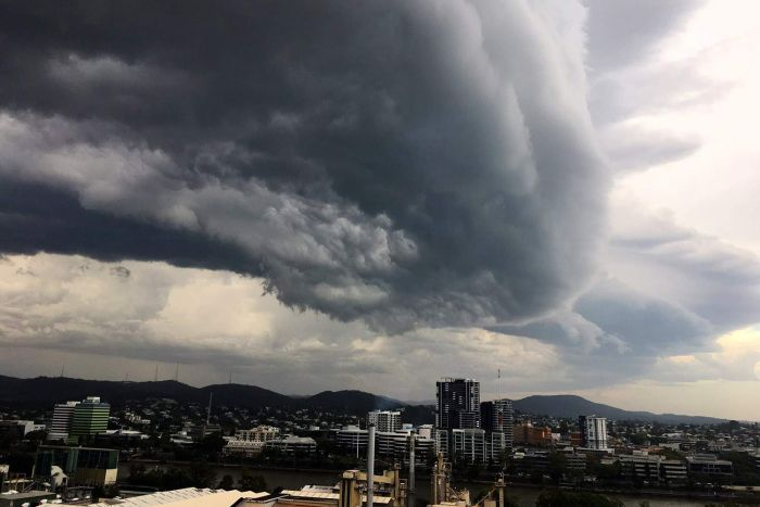 Storm clouds roll over Brisbane city.