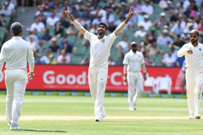India bowler Jasprit Bumrah points both hands to the sky as he celebrates a wicket during a Test against Australia at the MCG.