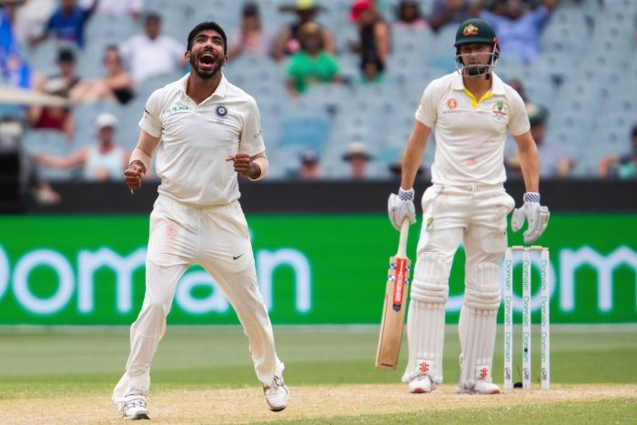 Jasprit Bumrah looks upwards and celebrates the wicket of Shaun Marsh, as the batsman looks on dejectedly