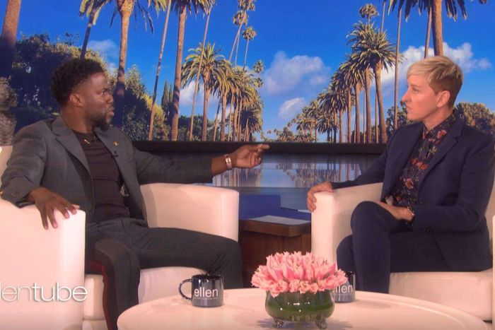 Kevin Hart sitting with Ellen DeGeneres on the set of her television show.