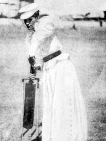 Louisa Varley, nee Gregory, holds up a cricket bat as if to bat a ball, in 1898.