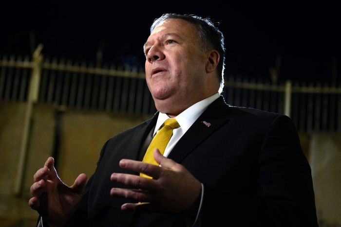 U.S. Secretary of State Mike Pompeo speaks while gesturing his hands.