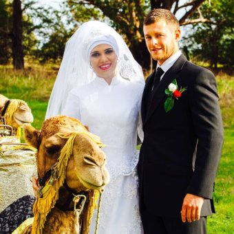 Noora Al Matori and Bogart Lamprey with a camel on their wedding day.