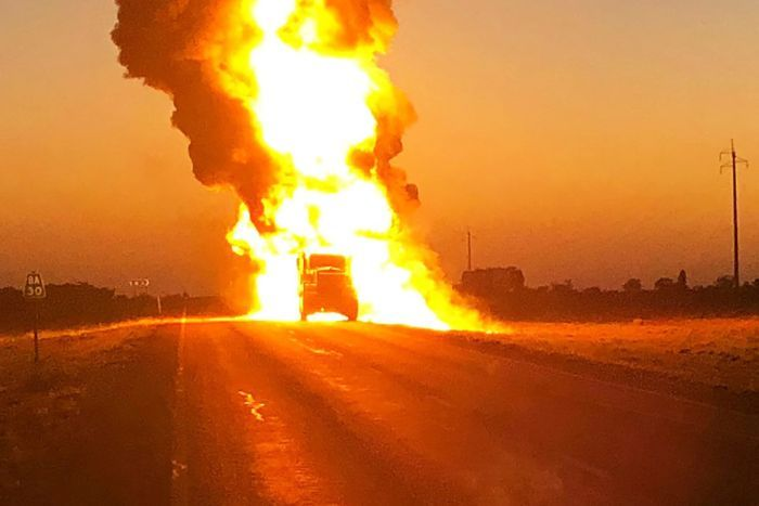 A fuel tanker on fire after it exploded