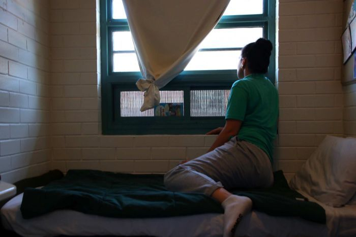 A female prisoner at Wandoo looks out the window of her cell.