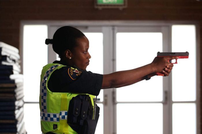 Maurine Riziki points a training weapon in Hobart