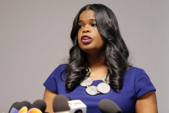 A close up pf attorney Kim Foxx speaking at a news conference