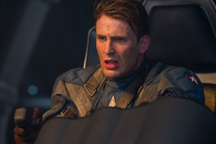 Steve Rogers in his Captain America outfit flying a plane.