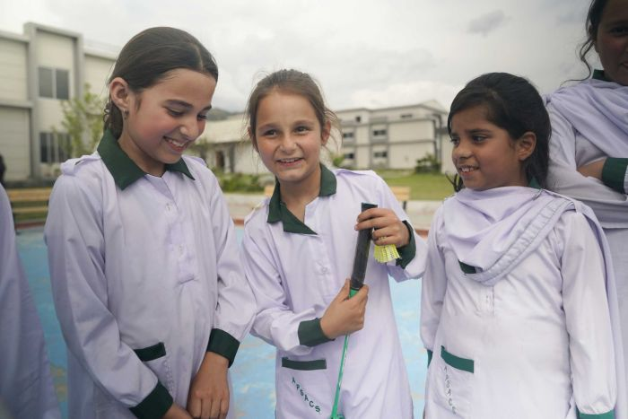 A group of Pakistani girls smiling