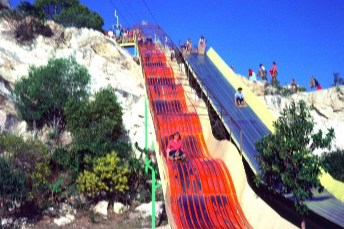 Kids use a slide at Magic Mountain, Gold Coast, in the 1980s