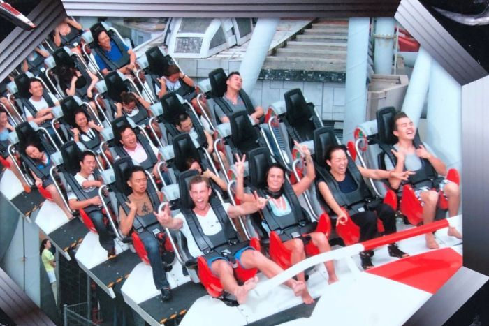 Thrill ride enthusiast Andrew Grover enjoying a roller coaster in Singapore