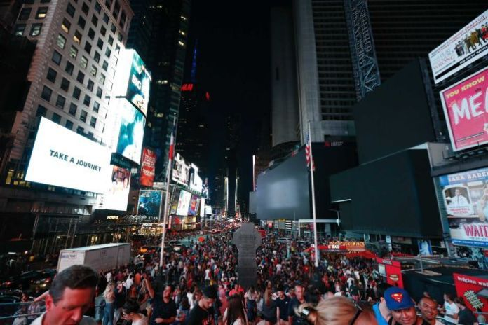 Hundreds of people visit Times Square because most of the area is surrounded by darkness without screens.