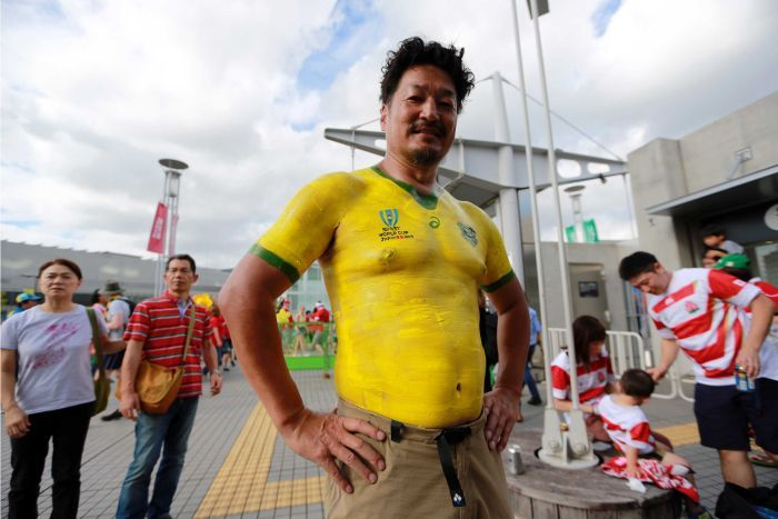 A male rugby union fan with a body-painted Wallabies jersey ahead of the Rugby World Cup match between Australia and Wales.