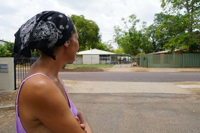 Eyewitness Sharlene Keegan looks across her street to a fence line and house where a brawl allegedly took place.