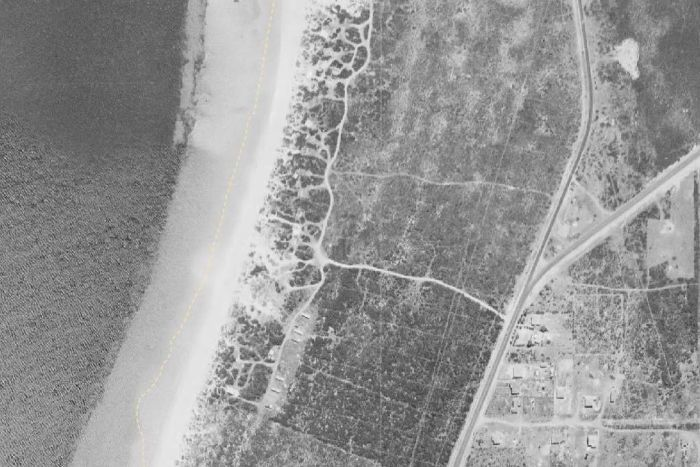 An aerial shot of the Kwinana Industrial precinct in 1954, showing scrubland and a cluster of beach side shacks.