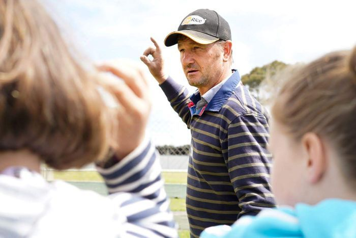 National champion kelpie trainer Joe Spicer talks the kids through a working dog drill