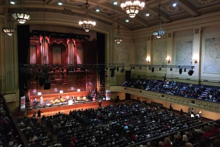 Audiences fill the inside of Melbourne Town Hall.