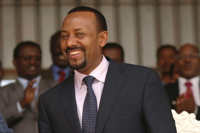 A man in a suit smiling