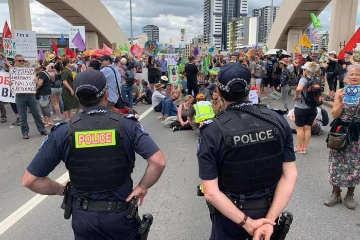 William Jolly Bridge in Brisbane's CBD blocked by hundreds of climate change protesters with police looking on.