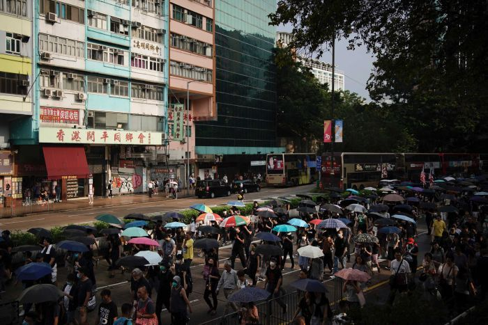 Protesters march on Nathan road during a protest in Hong Kong.