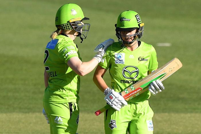 A Sydney Thunder WBBL player congratulates her teammate after they beat Brisbane Heat.