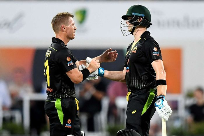 David Warner, without a helmet, shakes hands with Steve Smith.