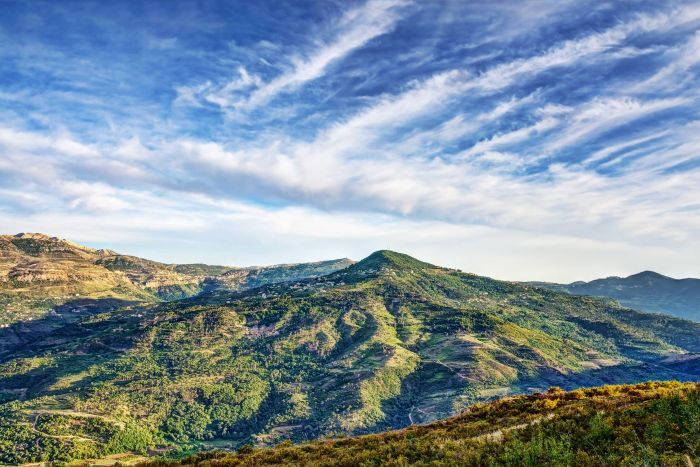 A landscape view of a mountainous area of Lebanon against a blue sky.