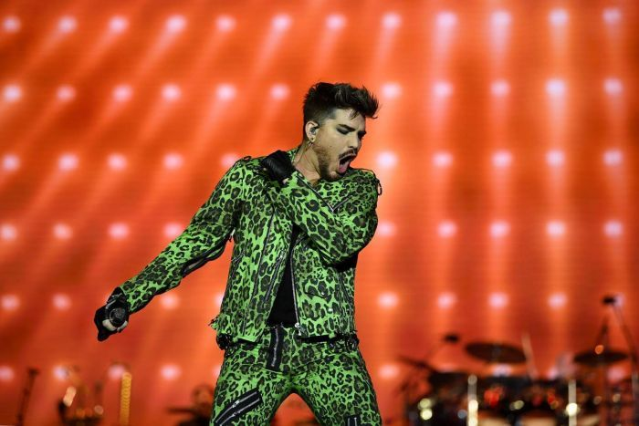 Adam Lambert performing on stage