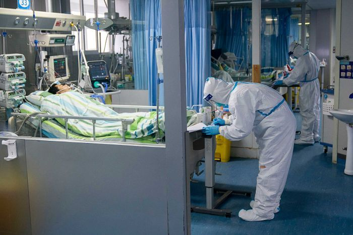 A medical worker attends to a patient in an intensive care unit at Wuhan University.