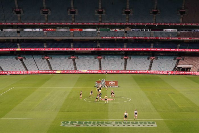 An AFL game is played at MCG without spectators in the stadium.