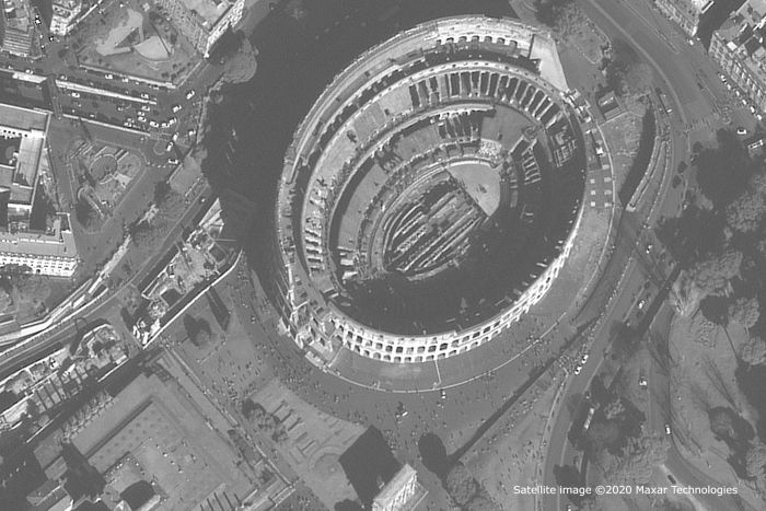 A satellite image of the Coliseum. People are dotted throughout the streets surrounding it.